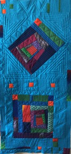 Log cabin quilted but not bound